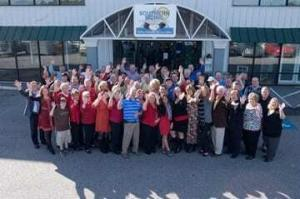 a group of our employees standing outside